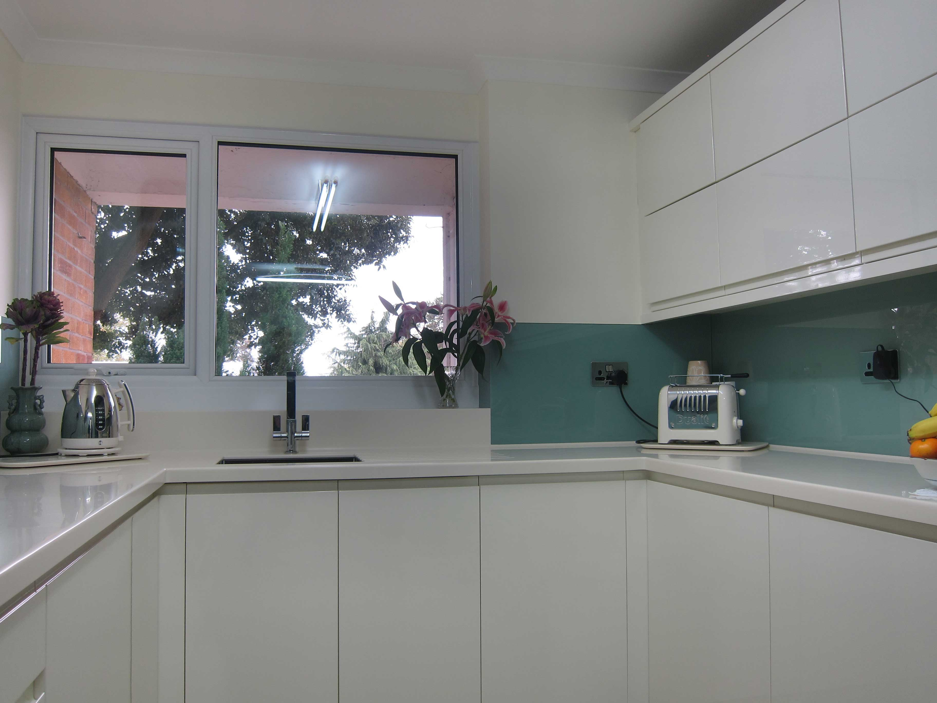 Rimini handleless cream glass splashback pebble kitchens Kitchen profile glass design